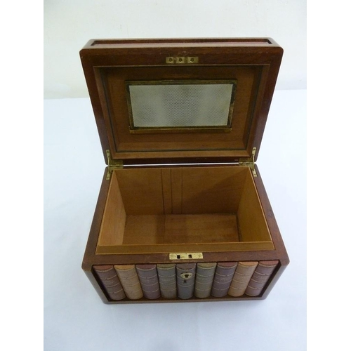 210 - A rectangular mahogany humidor with hinged lid, the front set with book spines...