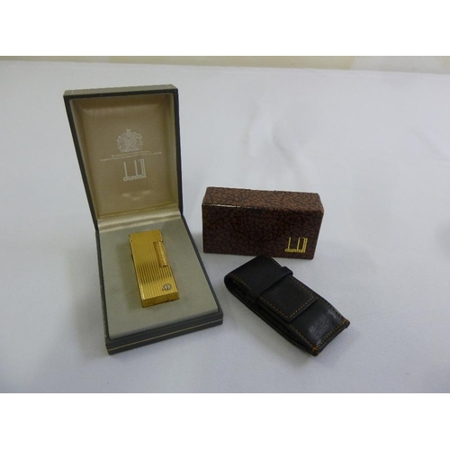 212 - Dunhill gold plated cigarette lighter in original packaging and a Dunhill leather case with original...