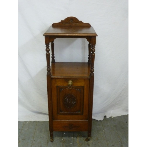 22 - A Victorian mahogany pot cabinet with hinged door...