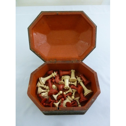 221 - A late 19th century chess set in hexagonal decorative box with hinged cover...