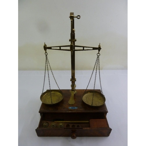 227 - A Victorian mahogany and brass balance scale with rectangular base and single drawer to include weig...