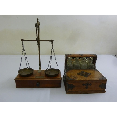 228 - A brass balance scale and a four bottle desk drinks cabinet...