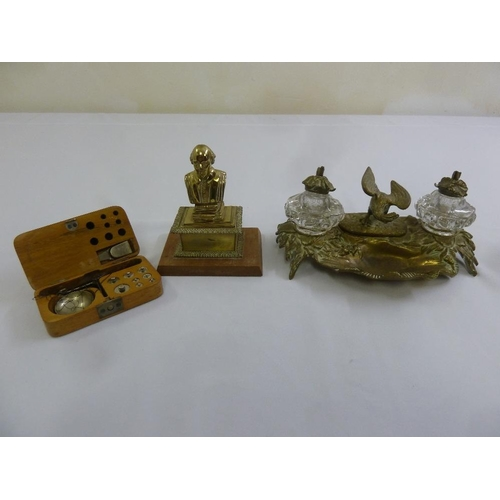 229 - A brass ink stand with two glass inkwells, a decorative brass paperweight and a cased set of balance...
