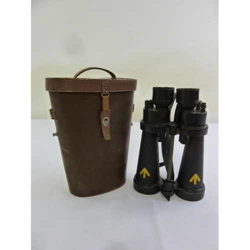 236 - A pair of WWII military binoculars in fitted leather case...