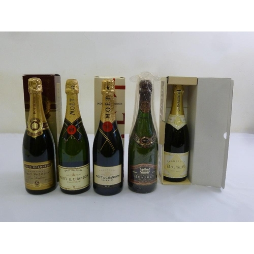 243 - Five 75cl bottles of champagne to include Louis Roederer, Moet and Chandon and Beaumet...