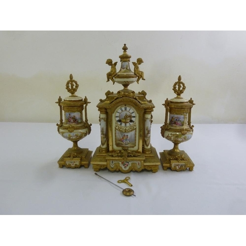 260 - A 19th century French ormolu mantle clock, with Sevres porcelain panels to the clock and matching ga...