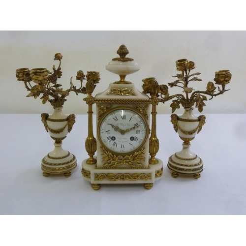 261 - A French Le Roy 19th century ormolu and white marble mantle clock, flanked by vase form garnitures s...