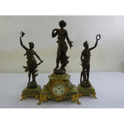 262 - An onyx and metal clock set with gilt metal mounts, enamel dial and Roman numerals...