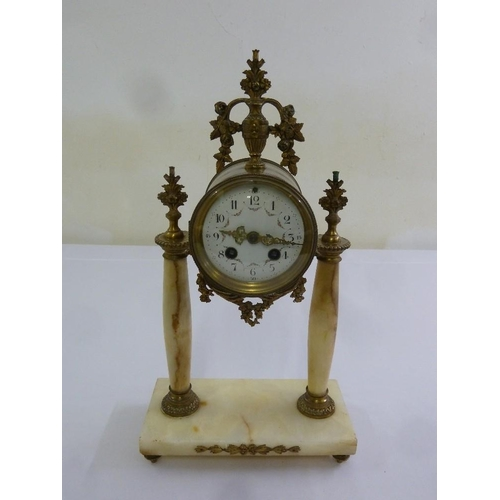 264 - A French marble and bronze mantle clock, circular enamel dial, Arabic numerals two train movement...