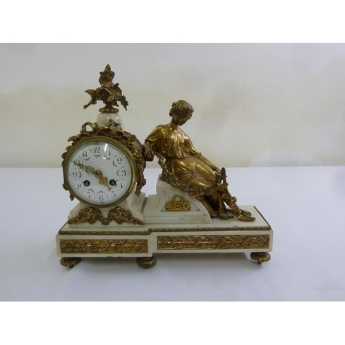 265 - A French 19th century gilt metal and white marble mantle clock, the circular enamel dial flanked by ...