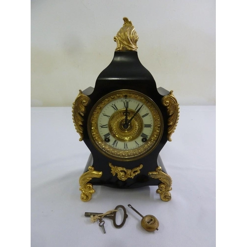 267 - A black slate with gilded mounts mantle clock,  enamel dial, Roman numerals, two train movement to i...