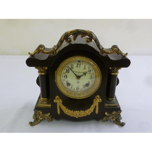 268 - A black marble mantle clock with gilt metal mounts, Roman numerals to the enamel dial, A/F...