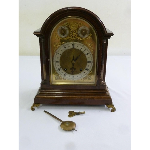 269 - A Victorian mahogany mantle clock silvered dial, Roman numerals, two train movement, to include key ...