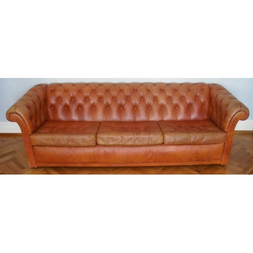 27 - A Victorian leather Chesterfield of customary form...