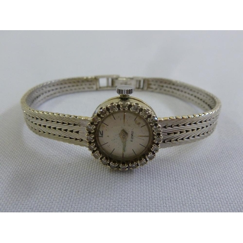 277 - 18ct yellow gold ladies wristwatch with diamond bezel...