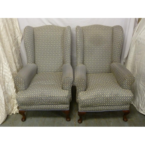 28 - A pair of Edwardian high back armchairs on cabriole legs...