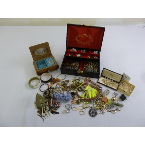 284 - A quantity of costume jewellery to include bangles, earrings and brooches and a musical jewellery bo...