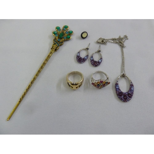 285 - A quantity of costume jewellery and a five carat sapphire...