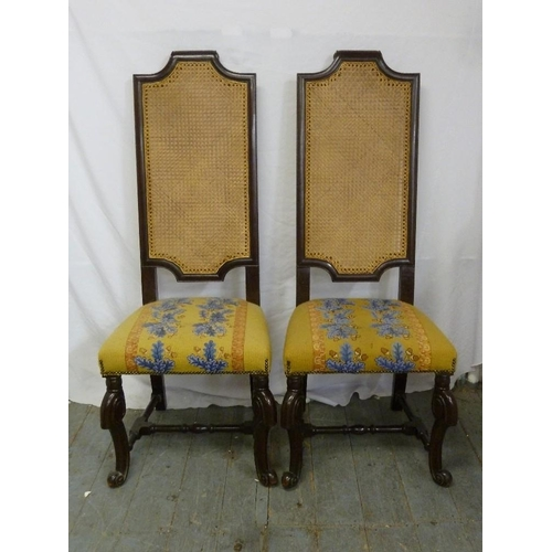 29 - A pair of mahogany high back occasional chairs with bergere backs and upholstered seats...