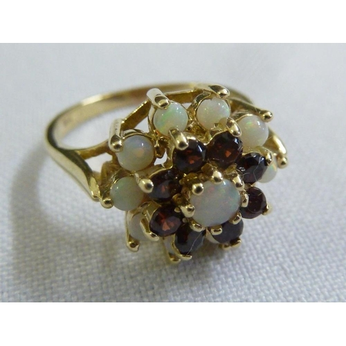 293 - 9ct yellow gold, opal and garnet ring...