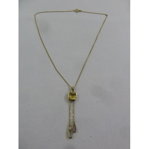 295 - A gold necklace with smokey topaz pendant, tested 14ct, approx 4.3g...