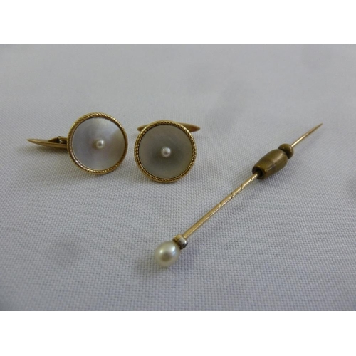 296 - A pair of 14ct gold cufflinks and a gold stick pin...