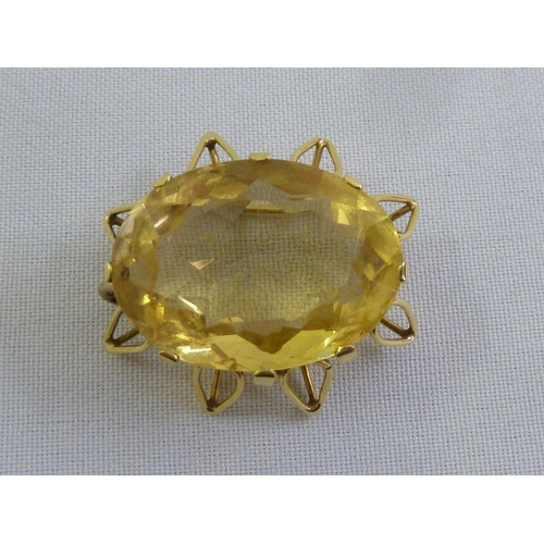 297 - A gold and smokey topaz brooch tested 9ct...