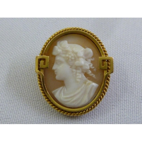 306 - A gold cameo brooch, tested 18ct...