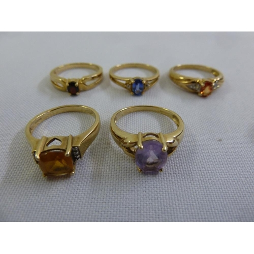 309 - Five 9ct gold rings set with various coloured stones...