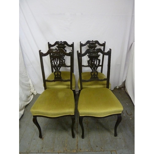 31 - Four Victorian mahogany dining chairs with upholstered seats...