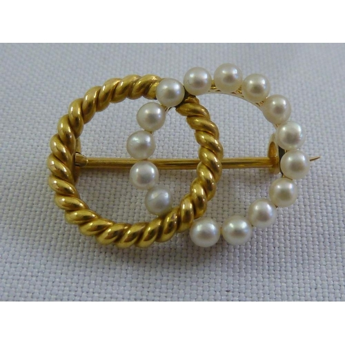 313 - A gold and seed pearl brooch, tested 22ct, approx 6g...