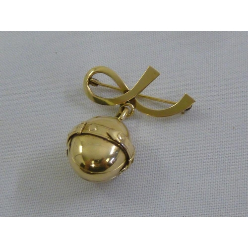 317 - A gold four panel articulated locket on a brooch bow, tested 14ct, approx 12g...