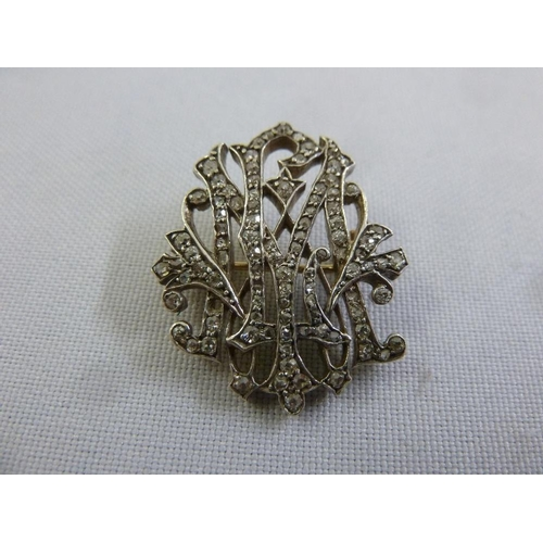 319 - A Victorian gold and diamond brooch, tested 9ct, approx 7.4g...