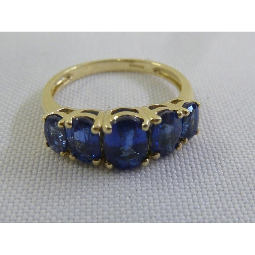 320 - 9ct yellow gold five stone sapphire ring...