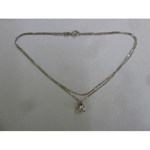 321 - 18ct white gold chain and diamond pendant...