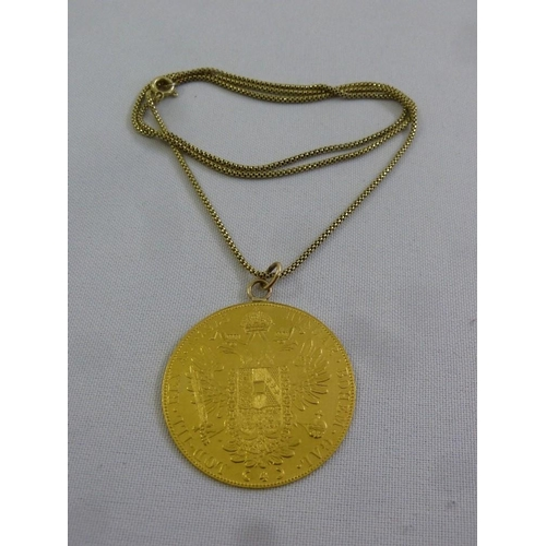 325 - 14ct gold chain set with an Austrian Ducat in pendant setting, approx 20.4g...