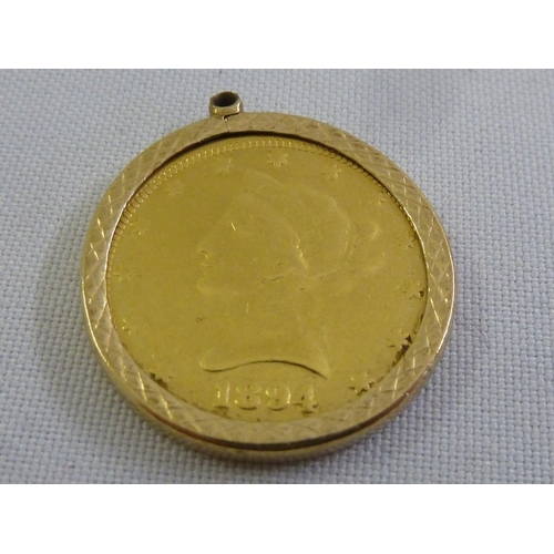 326 - USA ten dollar gold coin set in 9ct gold pendant frame, approx 20g...