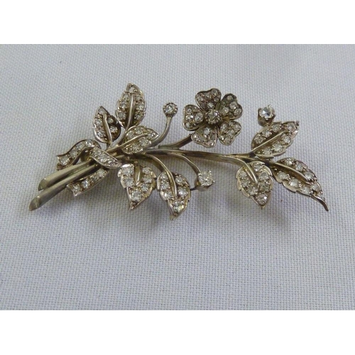 329 - A gold and diamond flower brooch, tested 9ct and silver, approx 10.9g...