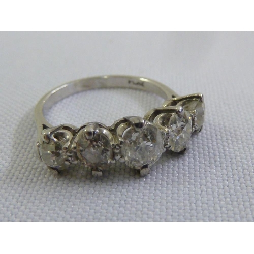 332 - A platinum and five stone diamond ring...