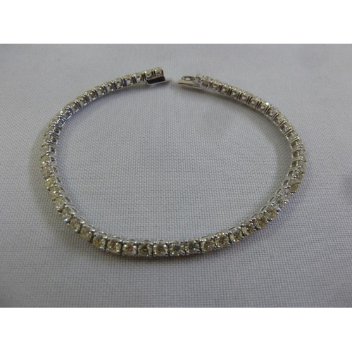 335 - 18ct white gold diamond line bracelet (diamonds approx 5.70 ct)...