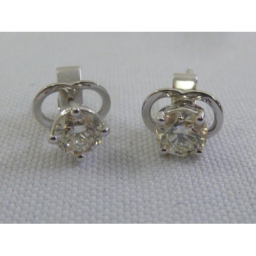 336 - A pair of 18ct white gold diamond earrings (diamonds approx 1 ct)...