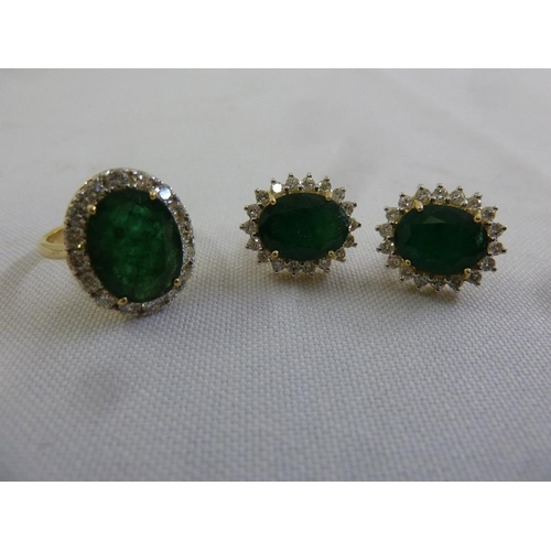 341 - A suite of 18ct yellow gold, diamond and emerald earrings and a matching ring...