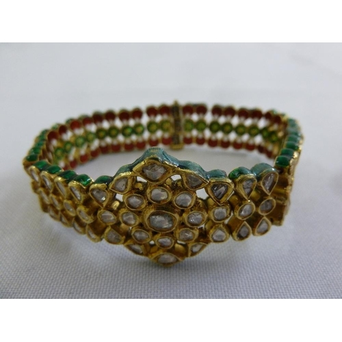 342 - An Indian gold, diamond and enamel articulated bracelet...