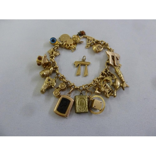 344 - 9ct gold charm bracelet with 43 charms, approx 51.4g...
