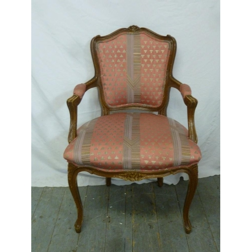 35 - A mahogany upholstered armchair on four cabriole legs...