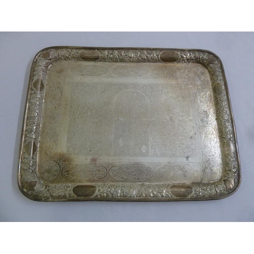353 - A Persian white metal tea tray, rounded rectangular, engraved with figures, animal, birds and leaves...