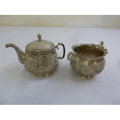 355 - A Persian white metal teapot and sugar bowl...