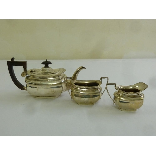 359 - A silver three piece bachelor teaset rounded rectangular with angled handles, Birmingham 1916...