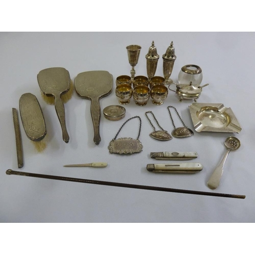 363 - A quantity of silver and white metal to include condiments, a dressing table set, wine labels and sw...