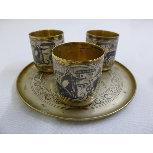 365 - Three Russian silver gilt and niello work Kiddush cups on a circular tray...